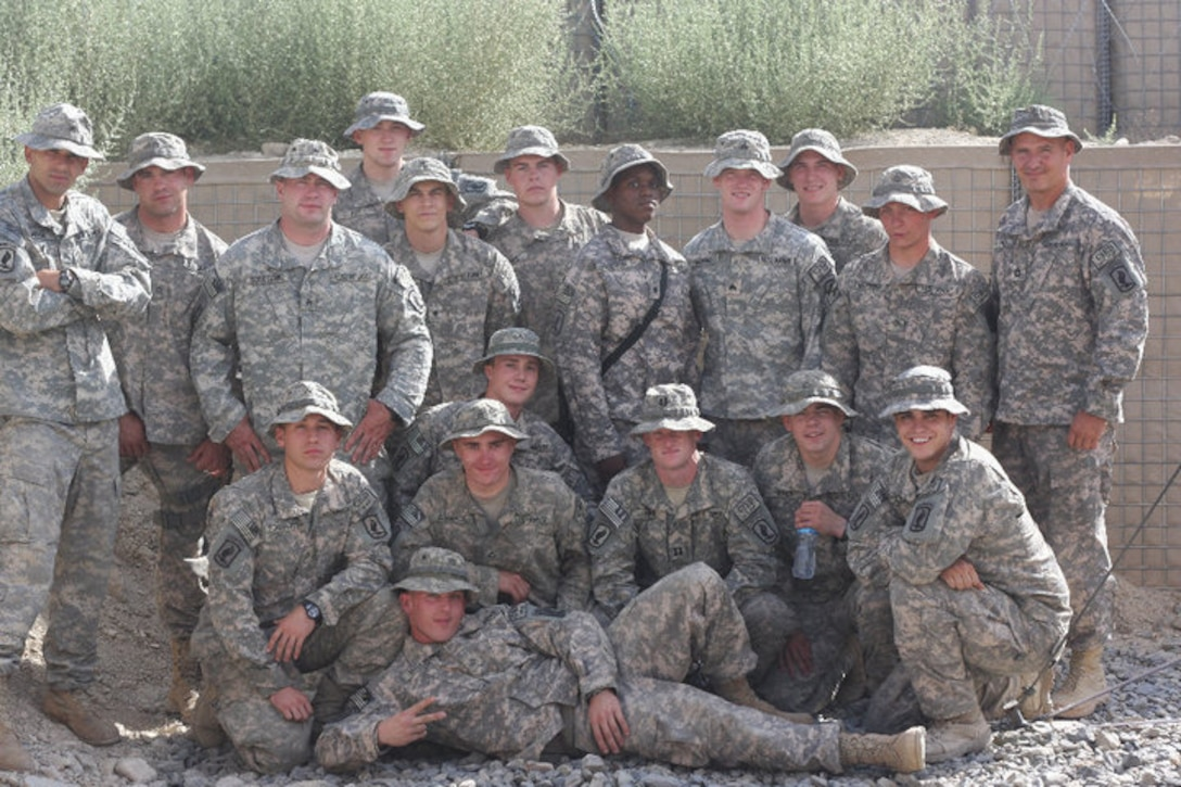 A group of soldiers pose for a photo.