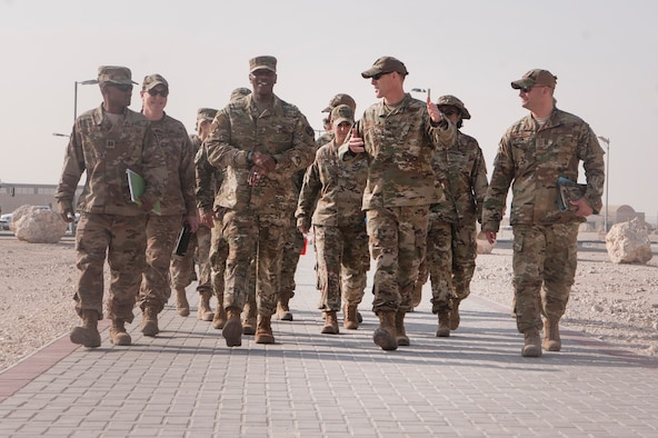 Chief Master Sgt. of the Air Force Kaleth O. Wright (center left) tours the Blatchford Preston Complex (BPC) dormitories with Col. Benjamin Jonsson, 379th Air Expeditionary Wing vice commander (center right), and other base leaders, at Al Udeid Air Base, Qatar, Dec. 20, 2018. Wright toured a dormitory and recognized Airmen with the cleanest rooms. (U.S. Air Force photo by Tech. Sgt. Christopher Hubenthal)