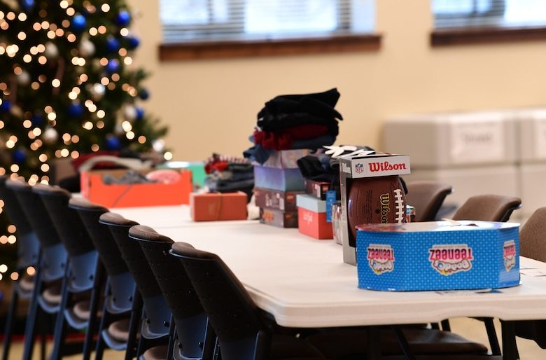 Gifts donated to families through the Angel Tree program are arranged on the tables according to a number assigned to each family for anonymity at Buckley Air Force Base, Colorado, Dec. 19, 2018.