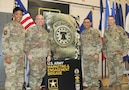 From left to right, USAREC Command Sergeant Major, CSM Tabitha A. Gavia, and USAREC Commander, Maj. Gen. Frank M. Muth, join USAMEB Commander, Col. Oscar H. Pintado, and USAMEB Command Sergeant Major, CSM Steven R. Laick to unveil branding commemorating the brigade's move to USAREC.