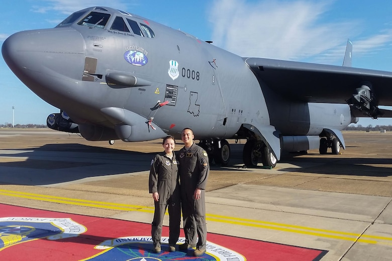 of a B-52 Stratofortress at Barksdale Air Force Base, Louisiana, December 1, 2018.  The couple shares a unique connection to Jacob Gill's grandfather, Albert Gill, who served as a navigator aboard the B-24 Liberator with the 307th Bomb Group during World War II.  Now, Hansena Gill serves as a navigator on the B-52 and Jacob Gill is assigned to the 307th Bomb Wing, the successor to the 307th Bomb Group.  (courtesy photo)