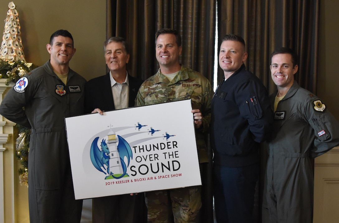 Keesler and Biloxi leadership, along with two U.S. Air Force Thunderbird pilots, pose for a photo during a press conference formally announcing Thunder Over the Sound: The Keesler and Biloxi Air and Space Show at the Biloxi Visitors Center, in Biloxi, Mississippi, Dec. 18, 2018. The press conference reviewed and confirmed information and acts for the air show and allowed attendees to meet with and ask questions of all speakers. (U.S. Air Force photo by Kemberly Groue)