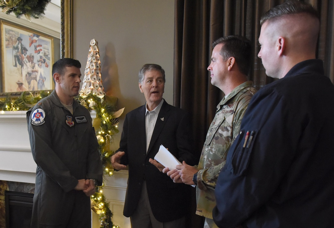 "Andrew ""Fo Fo"" Gilich, Biloxi mayor, speaks with U.S. Air Force Col. Lance Burnett, 81st Training Wing vice commander, and Maj. Jason ""Flack"" Markzon, inbound Thunderbird pilot #8, during a press conference formally announcing Thunder Over the Sound: The Keesler and Biloxi Air and Space Show at the Biloxi Visitors Center, in Biloxi, Mississippi, Dec. 18, 2018. The press conference reviewed and confirmed information and acts for the air show and allowed attendees to meet with and ask questions of all speakers. (U.S. Air Force photo by Kemberly Groue)"