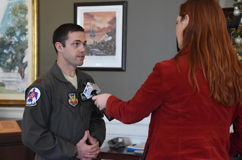 "U.S. Air Force Maj. Branden ""Ash"" Felker, outgoing Thunderbird pilot #8, answers interview questions during a press conference formally announcing Thunder Over the Sound: The Keesler and Biloxi Air and Space Show at the Biloxi Visitors Center, in Biloxi, Mississippi, Dec. 18, 2018. Felker was joined by Keesler and Biloxi leadership at the press conference which reviewed and confirmed information and acts for the air show and allowed attendees to meet with and ask questions of all speakers. (U.S. Air Force photo by Kemberly Groue)"