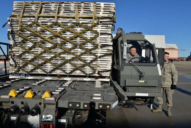 Senior Airman Andrew Poole and Airman 1st Class Hugh McMackin prepare to load a pallet onto the new pallet racking system using a Halvorsen 25K loader, Nov. 7, 2018, at Pease Air National Guard Base, N.H.(Photo by Master Sgt. Thomas Johnson, 157th ARW Public Affairs)