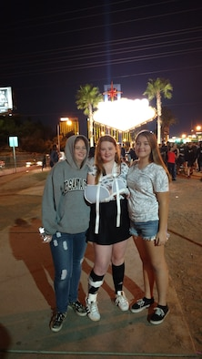 Tiffany and Samantha Pipken and their cousin Aundrea Scott (right) pose for a photo on the strip in Las Vegas, Nevada in March 2017. The outing is a family tradition started by Samantha's grandfather.  Although her grandfather is now deceased, Samantha didn't want her stroke to prevent the family from making the annual trek.  (Courtesy photo)