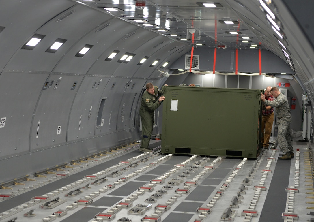 Senior Master Sgt. Patrick Martin and Senior Airman Andrew Poole position a pallet in the Boeing KC-46A Fuselage Trainer, Nov. 7, 2018, at Pease Air National Guard Base, N.H. (Photo by Master Sgt. Thomas Johnson, 157th ARW Public Affairs)
