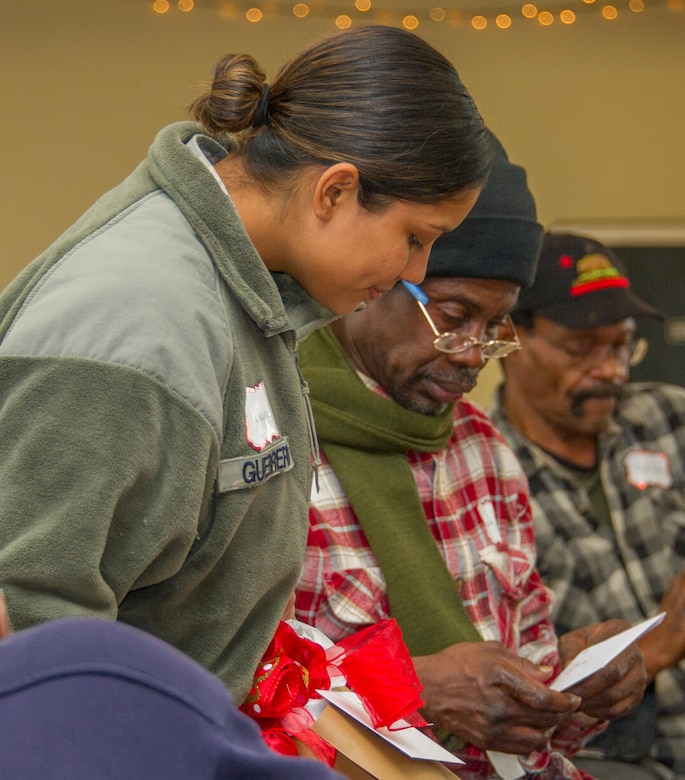 Reserve Citizen and active-duty Airmen from Barksdale Air Force Base along with members of Volunteers of America North Louisiana brought gifts and prepared a meal for a Christmas party at the Safe Haven shelter for homeless veterans, in Shreveport, Louisiana, December 19, 2018. (U.S. Air Force photo by Airman 1st Class Maxwell Daigle)