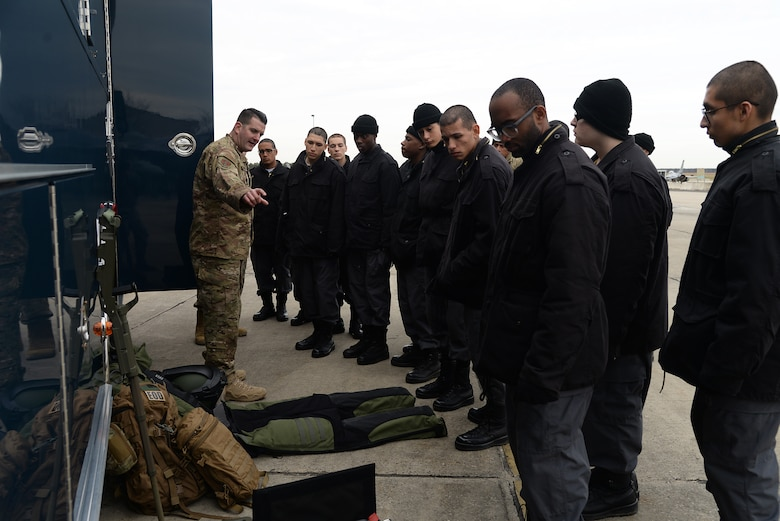 A picture of cadets from the NJ Youth ChalleNGe Academy tours the 177th Fighter Wing of the New Jersey Air National Guard receiving a briefing on Explosives Ordnance Disposal equipment from U.S. Air Force Tech. Sgt. Philip Douglass, EOD technician with the 177th Fighter Wing.