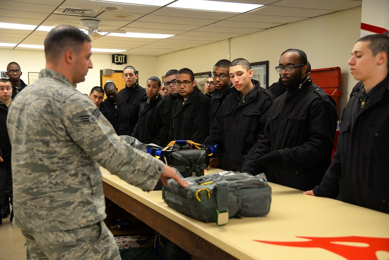 A picture of Cadets from the New Jersey Youth ChalleNGe Academy receiving a briefing from aircrew flight equipment personnel at the 177th Fighter Wing.