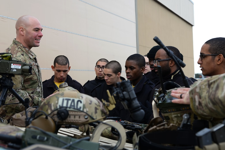 A picture of Cadets from the New Jersey Youth ChalleNGe Academy receiving a briefing on Tactical Air Control Party equipment from U.S. Air Force Staff Sgt. Ryan Muller, Joint Terminal Attack Controller with the 227th Air Support Squadron, at the 177th Fighter Wing.