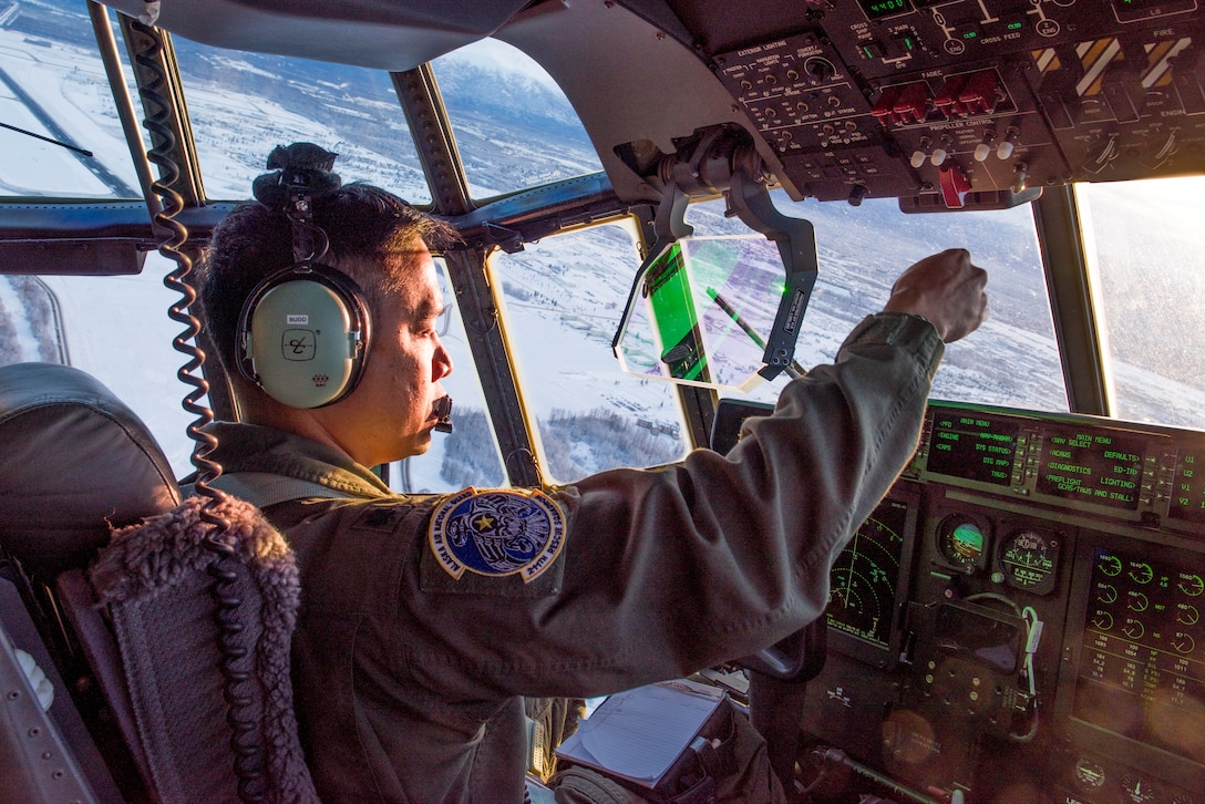 "Lt.Col. Eric Budd, a pilot with the 211th Rescue Squadron, gives direction as the aircraft commander of a C130J ""Combat King II"" during an aerial damage assessment Nov. 30, 2018, flying over Southcentral Alaska. In a matter of hours, members of the Alaska Air National Guard's Maintenance and Operation groups turned a planned community engagement into an aerial survey of earthquake damage, reporting findings to the State of Alaska's Joint Operations Center."