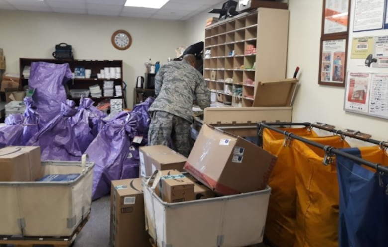 U.S. Air Force Staff Sgt. McGarrette Dela Cruz, administration management technician, sorts through incoming mail as the postmaster of the 607th Material Maintenance Squadron at Daegu Air Base, Republic of Korea, Dec. 14, 2018. Dela Cruz travels to multiple bases throughout the week in support of the 607th MMS, in a one-person deep position. (Courtesy photo by U.S. Air Force Tech. Sgt. James Frye)