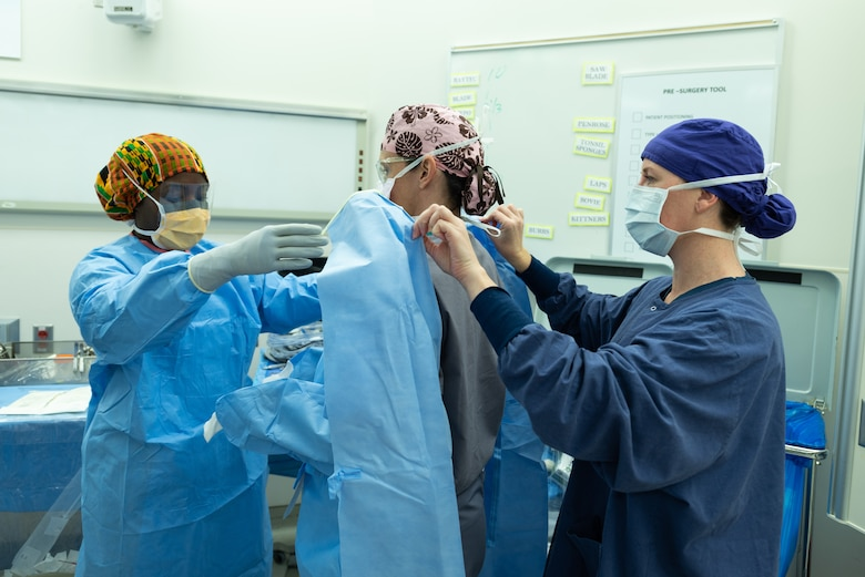 U.S. service members assigned to a joint surgical team prepare for surgery at Joint Base-Langley-Eustis, Virginia, Dec. 11, 2018.