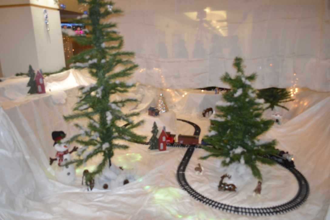 A train circles a winter landscape decorated with items representing the mission of the Construction and Equipment supply chain as part of their entry in the Defense Logistics Agency Troop Support's 2018 holiday decorating contest in Philadelphia Dec. 20, 2018.