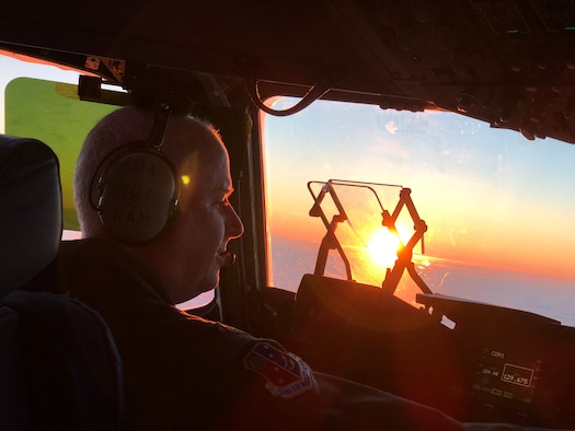 U.S. Air Force Col. Thomas O. Pemberton, 514th Air Mobility Wing commander, pilots a C-17 Globemaster III into the sunrise over Europe, en route to Ramstein Air Base, Germany, December 15, 2018.