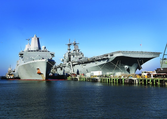 USS Kearsarge (LHD 3) and USS Arlington (LPD 24) in port gearing up for deployment