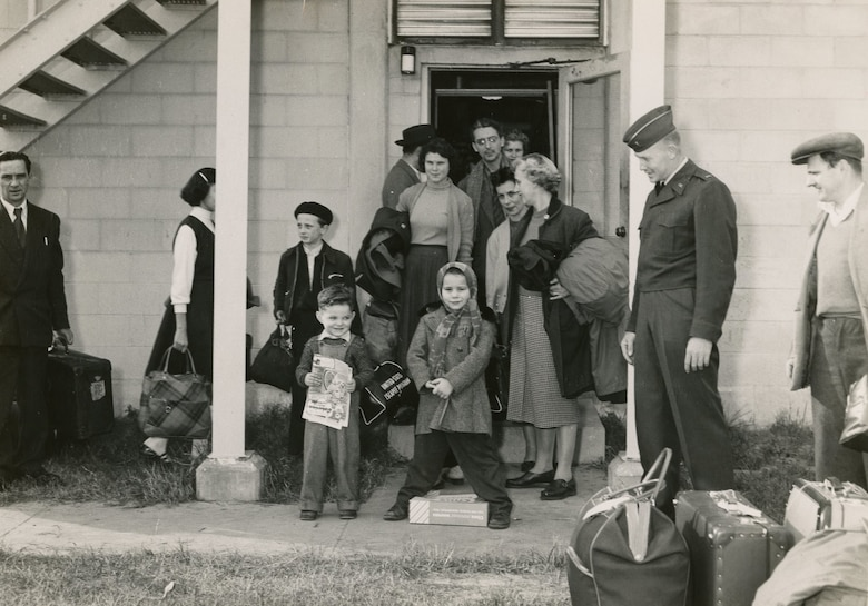 Hungarian refugees wait outside building 246 at Charleston Air Force Base, S.C., in December of 1956.