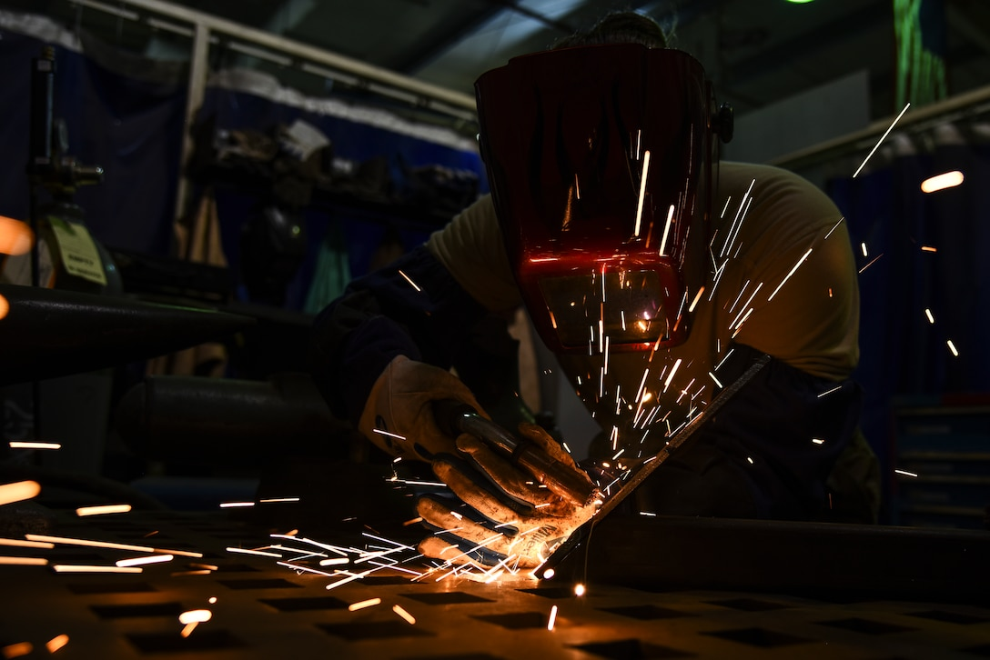 A metal technician welds