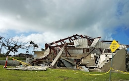 A school building on the Island of Taipan in the Northern Mariana Islands sustained severe damage from Super Typhoon Yutu in fall 2018. Personnel from the New York District have deployed to the area building 66 temporary classrooms for students displaced from Hopwood Middle School and Northern Marianas College. (Photo: Jason Shea, Project Manager).