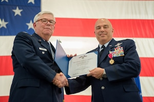 Col. Ken Dale (right), outgoing commander of the 123rd Maintenance Group, receives the Legion of Merit from retired Col. Michael Harden, former commander of the 123rd Airlift Wing, during Dale's retirement ceremony at the Kentucky Air National Guard Base in Louisville, Ky., on Dec. 1, 2018. Dale is retiring after more than 38 years of service to the Kentucky Air National Guard. (U.S. Air National Guard photo by Staff Sgt. Joshua Horton)
