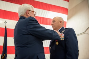 Col. Ken Dale (right), outgoing commander of the 123rd Maintenance Group, is pinned with the Distinguished Service Medal by retired Col. Michael Harden, former commander of the 123rd Airlift Wing, during Dale's retirement ceremony at the Kentucky Air National Guard Base in Louisville, Ky., on Dec. 1, 2018. Dale is retiring after more than 38 years of service to the Kentucky Air National Guard. (U.S. Air National Guard photo by Staff Sgt. Joshua Horton)