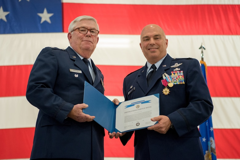 Col. Ken Dale (right), outgoing commander of the 123rd Maintenance Group, receives the Distinguished Service Medal from retired Col. Michael Harden, former commander of the 123rd Airlift Wing, during Dale's retirement ceremony at the Kentucky Air National Guard Base in Louisville, Ky., on Dec. 1, 2018. Dale is retiring after more than 38 years of service to the Kentucky Air National Guard. (U.S. Air National Guard photo by Staff Sgt. Joshua Horton)