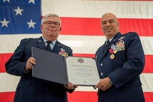 Col. Ken Dale (right), outgoing commander of the 123rd Maintenance Group, receives a certificate of retirement from retired Col. Michael Harden, former commander of the 123rd Airlift Wing, during Dale's retirement ceremony at the Kentucky Air National Guard Base in Louisville, Ky., on Dec. 1, 2018. Dale is retiring after more than 38 years of service to the Kentucky Air National Guard. (U.S. Air National Guard photo by Staff Sgt. Joshua Horton)