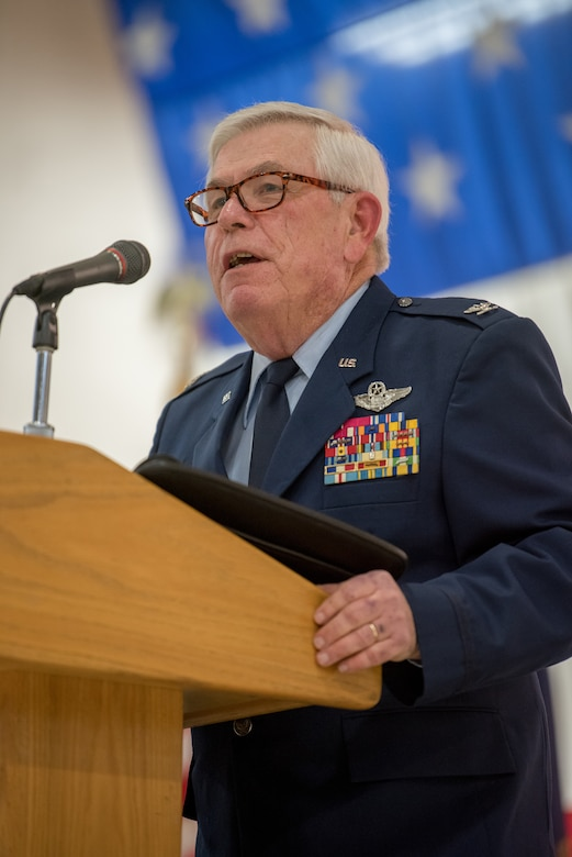 Retired Col. Michael Harden, former commander of the 123rd Airlift Wing, speaks at a retirement ceremony for Col. Ken Dale at the Kentucky Air National Guard Base in Louisville, Ky., on Dec. 1, 2018. Dale, outgoing commander of the 123rd Maintenance Group, served the Kentucky Air National Guard for 38 years. (U.S. Air National Guard photo by Staff Sgt. Joshua Horton)