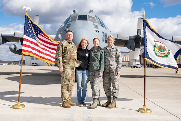 Lt. Col. Andrew Farmer, 130th Logistics Readiness Squadron Commander, stands with his daughters Halle Farmer, Staff Sgt. Alexis Farmer and Senior Airman Carly Farmer in front of a C-130H Nov. 3, 2018 at McLaughlin Air National Guard Base, Charleston, W.Va. (U.S. Air National Guard Photo by Airman 1st Class Caleb Vance)