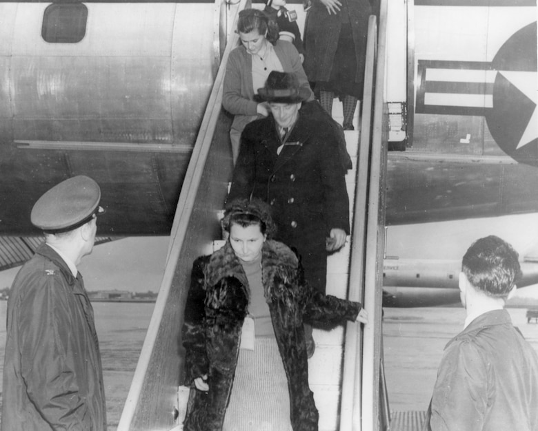 Col. Clinton C. Wasem, 1608th Air Transport Wing Commander, Charleston Air Force Base, S.C., greets Hungarian refugees on Dec. 10, 1956, as they arrive at Charleston AFB on a C-121 Constellation