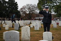 A U.S. Navy Sailor salutes the grave of a fallen member of the Armed Forces in honor of National Wreaths Across America Day at the Hampton National Cemetery in Hampton, Virginia, Dec. 15, 2018.