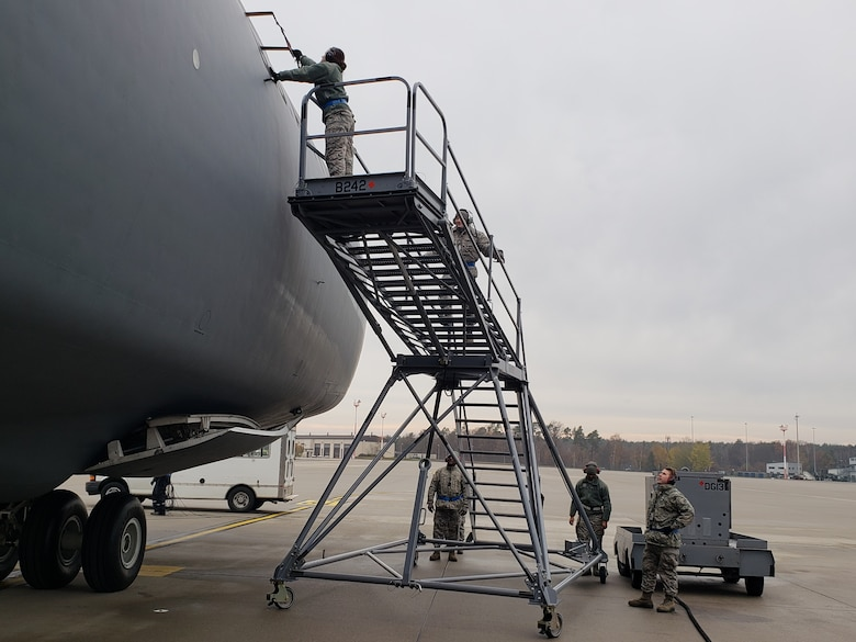 Aircraft maintainers assigned to the 512th Airlift Wing perform a visor check on a C-5M Super Galaxy at Ramstein Air Base, Germany, Nov. 29, 2018. More than 30 512th maintainers traveled to Ramstein AB as a part of a two-week enroute training mission. (Courtesy photo)