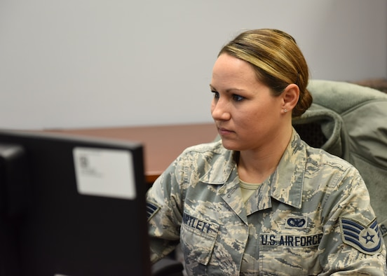 Staff Sgt. Gena Bartlett, command chief's assistant with the 911th Airlift Wing, works on her computer at the Pittsburgh International Airport Air Reserve Station, Pennsylvania, Dec. 2, 2018. Bartlett is a member of the 911th Security Forces Squadron currently serving as the command chief assistant. She said that she loves the people and the work both in the wing and at 911th SFS. (U.S. Air Force Photo by Senior Airman Grace Thomson)