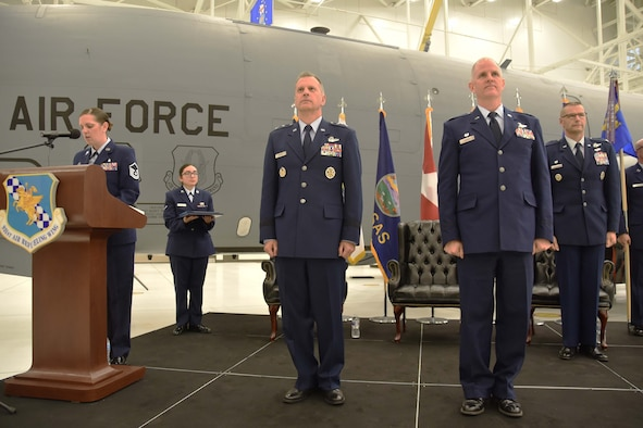 (Left to right) Master Sgt.Tabetha Coley, 931st Air Refueling Wing in-service recruiter, narrates the 931 ARW Change of Command ceremony Dec. 1, 2018, McConnell Air Force Base, Kan. Col. Phil Heseltine, 931 ARW commander, selected Coley to narrate the ceremony because of her year-long role in helping him join the Reserve.