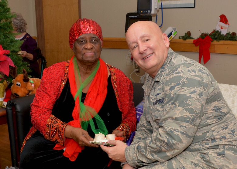 507th Mission Support Group Commander, Col. Richard Ropac, visits with a veteran Dec. 20, 2018, at the Norman Veterans Center in Norman, Oklahoma. 507th Air Refueling Wing Airmen delivered gifts and served snacks to the veterans for the holidays. (U.S. Air Force photo by Tech. Sgt. Samantha Mathison)