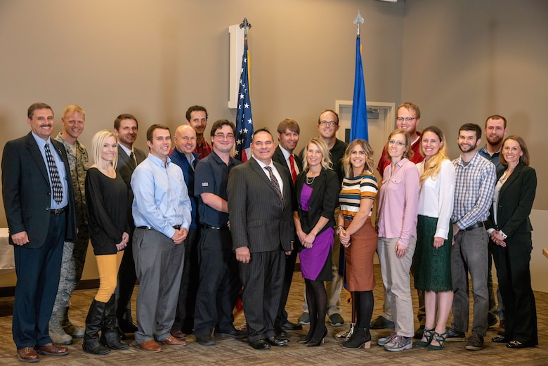 Air Force Nuclear Weapons Center interns participate in a graduation ceremony Nov. 1, 2018, at the AFNWC's ICBM Systems Directorate located at Hill Air Force Base, Utah. From left in front row are Kerry Sparks, Kira Valentine, Justin Weight, Phillip Ingraham, Dave Stacey, Shannon Clugston, Mykenzie Hamblin, Sariah Cassidy, Kelly Squires, Eric Salas and Amber Hampton. In back from left are Col. Luke Cropsey, Alex Nebeker, Michael Sabin, Jacob Jackson, Page Wiberg, Jay Lindstrom, Jonathan Tayler and Hayden Christensen. (Courtesy photo)
