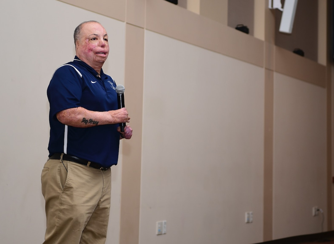 Senior Master Sgt. Israel Del Toro, 98th Flying Training Squadron accelerated freefall training program superintendent, shares his story of overcoming adversity with members of Team Buckley, Dec. 20, 2018, at Buckley Air Force Base, Colo. Del Toro was injured in Afghanistan, Dec. 4, 2005, and became the first 100 percent disabled Airman to reenlist in the Air Force on Feb. 8, 2010. (U.S. Air Force photo by Airman 1st Class Michael D. Mathews)