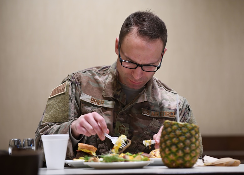 Senior Master Sgt. David Brier, the 28th Force Support Squadron senior enlisted manager, judges the three dishes presented to him during the Chef of the Quarter cook-off competition at the Raider Café on Ellsworth Air Force Base, S.D., Dec. 18, 2018. Brier judged the dishes alongside Col. Eric Hresko, the 28th Bomb Wing vice commander, and Chief Master Sgt. Justin Walker, the 28th Mission Support Group superintendent. (U.S. Air Force photo by Airman 1st Class Christina Bennett)