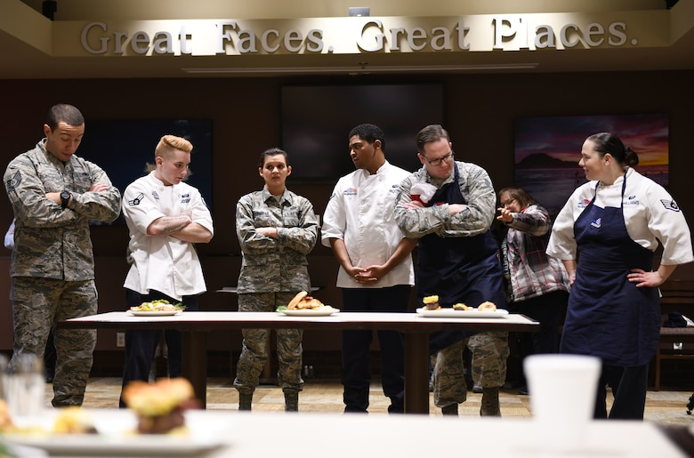 Contestants wait for the judges to vote on their plates at the Chef of the Quarter cook-off competition at the Raider Café on Ellsworth Air Force Base, S.D., Dec. 18, 2018. Each team created a plate that went along with the brunch theme and incorporated two secret ingredients: fennel and avocado. The plates were judged by taste, presentation, creativity and originality. (U.S. Air Force photo by Airman 1st Class Christina Bennett)