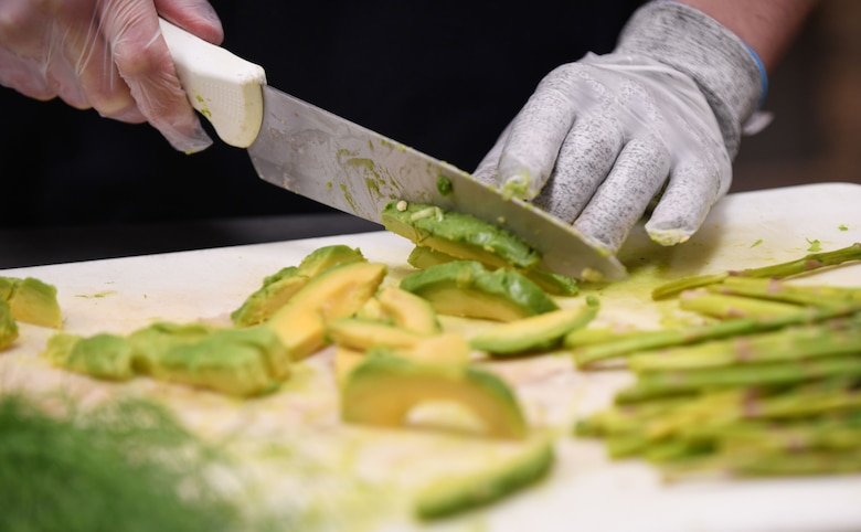 "Avocado and fennel are revealed as the two secret ingredients at the beginning of the Chef of the Quarter cook-off competition at the Raider Café on Ellsworth Air Force Base, S.D., Dec. 18, 2018.  Contestants were required to incorporate the two special ingredients into their plates while sticking to the theme of ""brunch."" (U.S. Air Force photo by Airman 1st Class Christina Bennett)"
