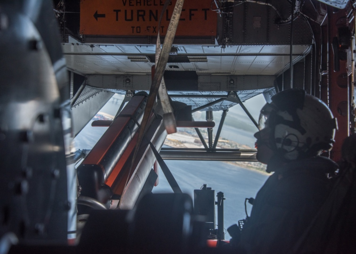 Flight Test crew member of Helicopter Mine Countermeasures Squadron 15 shown in flight ready to begin Government Acceptance Testing of the AN/AQS-24C Mine Detecting Set June 19, 2018. U.S. Navy photo by Anthony Powers.