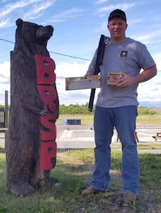 SFC Stoa stands with his trophies at the Alaska State Trapshooting Championship.