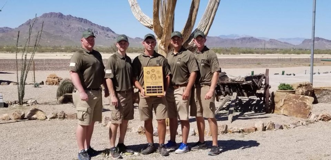 Army Skeet Team stands with their trophy.
