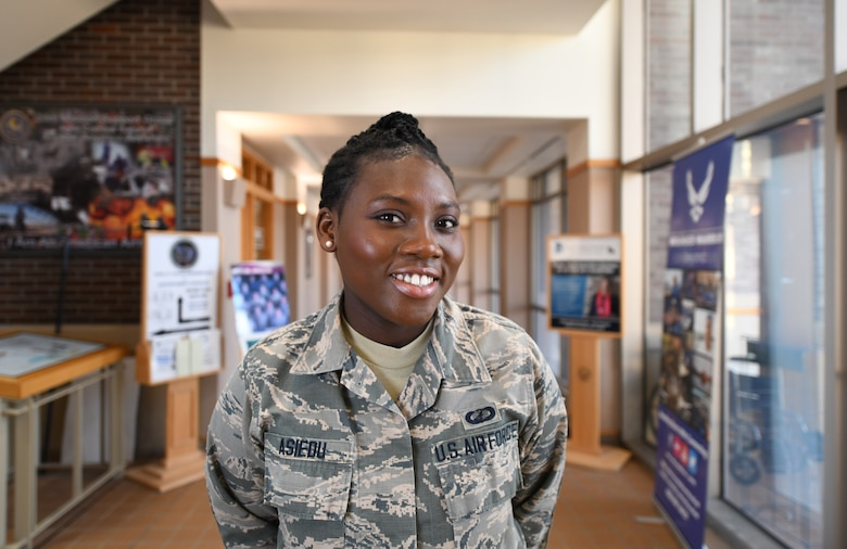 Senior Airman Bernice Asiedu, a 28th Comptroller Squadron customer service technician, stands in the Rushmore Building on Ellsworth Air Force Base, S.D., Dec. 20, 2018. Asiedu, originally from Ghana, came to the U.S. via the Electronic Diversity Lottery.  In the year she was selected, more than 14 million people applied. Asiedu had less than a 1 percent chance of being selected. (U.S. Air Force photo by Airman 1st Class Thomas Karol)