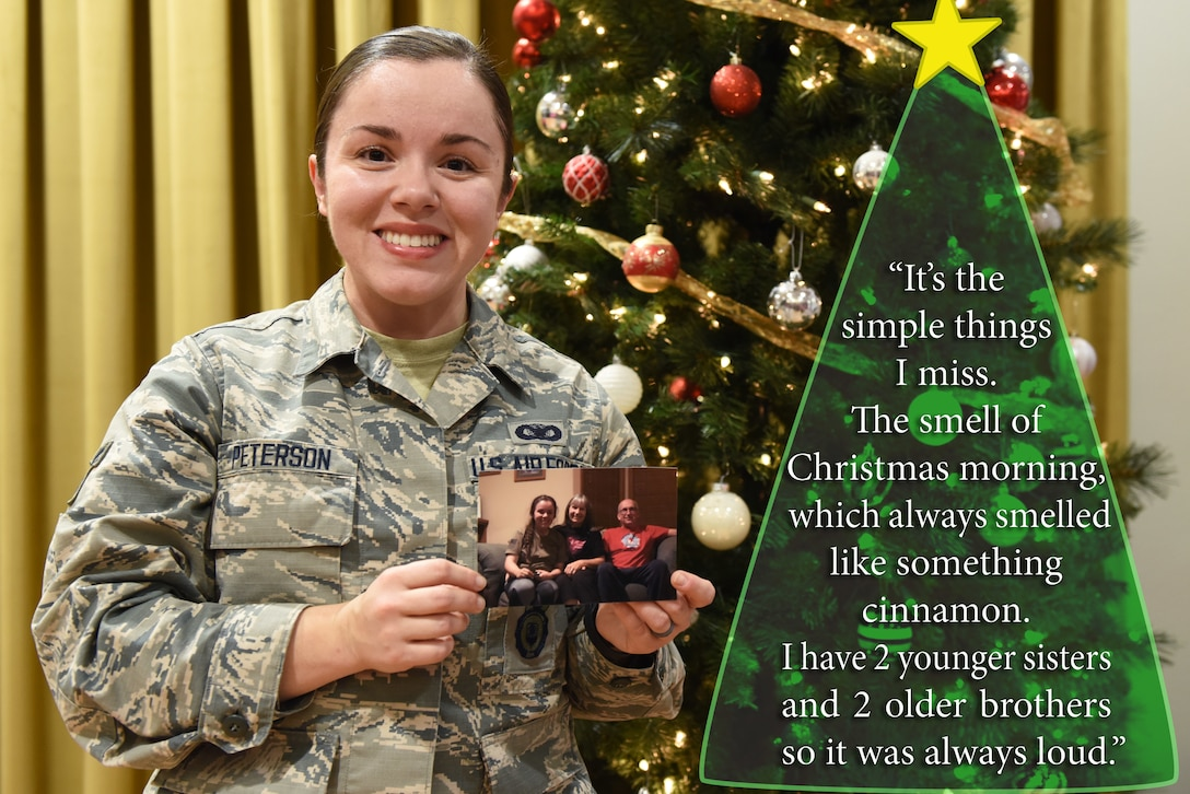 U.S. Air Force Airman 1st Class Victoria Peterson, 39th Security Forces Squadron member, holds a picture of her family at Incirlik Air Base, Turkey, Dec. 14, 2018.