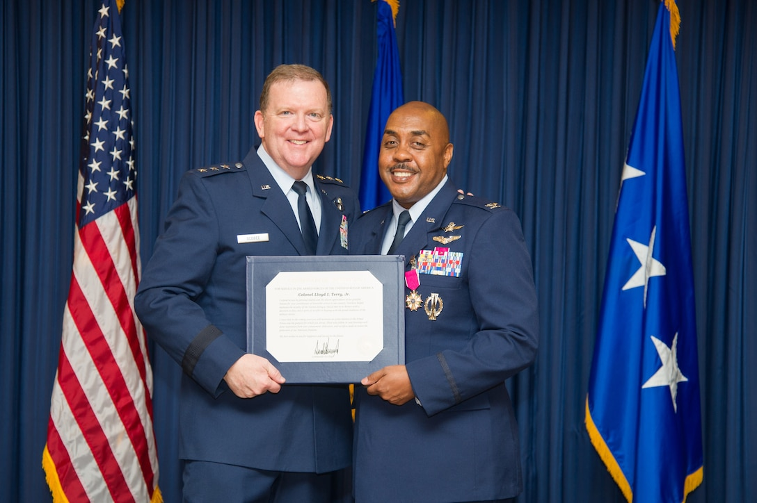 Lt. Gen. Richard Scobee, Commander, Air Force Reserve Command and Chief, Air Force Reserve, presents Col. Lloyd Terry with a certificate of appreciation, Friday, December 14, at Naval Air Station Fort Worth Joint Reserve Base, Texas, culminating a 35 year career.