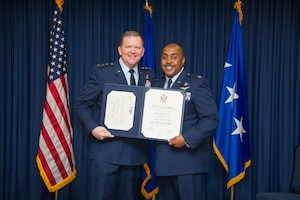 Lt. Gen. Richard Scobee, Commander, Air Force Reserve Command and Chief, Air Force Reserve, presents Col. Lloyd Terry with his retirement certificate and certificate of appreciation, Friday, December 14, at Naval Air Station Fort Worth Joint Reserve Base, Texas, culminating a 35 year career.