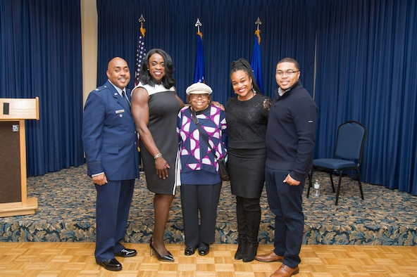 Colonel Lloyd Terry poses for a picture with his family (L to R his wife, Olivia, his mother, Juanita Terry, his daughter in law, Katoya Terry and his son Lloyd Terry III) after his retirement ceremony, Friday, December 14 at Naval Air Station Fort Worth Joint Reserve Base, Texas.