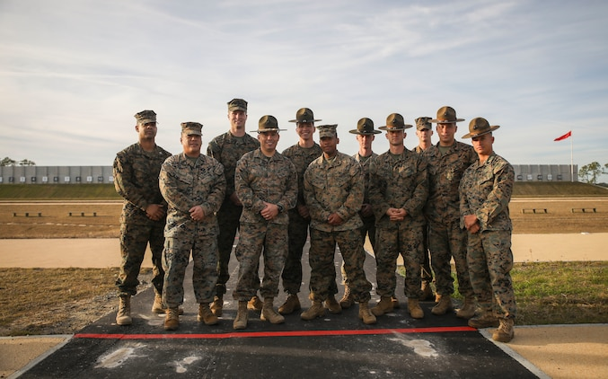 Members of the Marine Corps Recruit Depot Parris Island shooting team pose for a photo on the newly-renovated Inchon Rifle Range on Parris Island, S.C. Dec. 18, 2018. After more than two years of renovation and reconstruction, the 50 lane firing range was rebuilt to include new impact and side safety berms, newly paved firing lines, roads, storm water collection and management systems, and irrigation systems. 